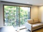 Sliding glass door at balcony with garden view