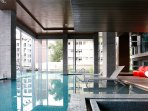 Edge-less swimming pool with city views