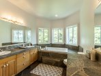 Large attached master bath with jacuzzi tub and separate shower