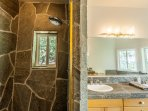 Custom shower surrounded by stone