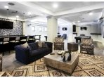 Entertainment Rm with Pool Tables; WiFi, Bar, Cards and Games Tables, Library, Tvs.