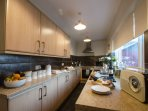 Kitchen fully equipped to look after 8 with conventional oven, hob, microwave, fridge & washer dryer
