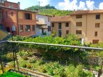 Pretty terrace with hill, garden and roof top views