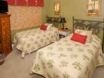 3rd bedroom with two twin beds, night stand, beachy decor