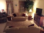 Our living area is cosy and relaxing.  We have a large flat screen tv,, wifi, and cable.