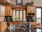 Kitchen island with gas range; great for cooking and serving