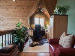 Upstairs loft with desk with room for your laptop