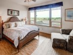 Master Bedroom with a king sized-bed and a private deck located on main floor.