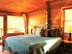Master bedroom with authentic timber logs.