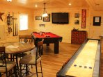 Game room for family fun.  Shuffleboard table, Pool Table, Card Table, Flat Panel TV & Foosball!