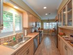 The kitchen is fully equipped and stocked with dishes, utensils, and cookware