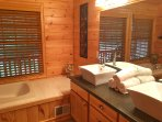 Private master bath with spa-like amenities.
