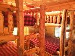 Bunk room with Lumberjack theme sleeps 4 singles