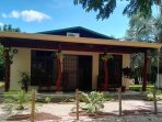Palma Real cottage, overview. Also it's surrounded by palm trees, native trees and tropical plants.