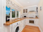 fully equipped kitchen extra fridge in garage stairs from kitchen take you up to living areas