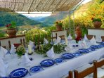 At the other side of the Villa, you will find the main shadowed dining area, with excellent views