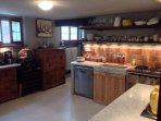 Easily accessible from the out and indoor dining areas, you will find a fully fitted Tuscan kitchen.