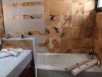 EN SUITE BATHROOM WITH BATHTUB AND SHOWER