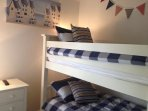 The second bedroom has full-size bunks and a pull out trundle bed for the 5th guest if needed