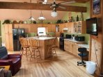 The enormous kitchen features a large island with lots of counter space for cooking and entertaining