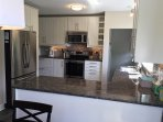 Kitchen with granite countertops and new kitchen appliences