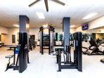 Brand New Gym with Views of the Beach and Pool.