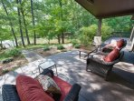 Relax on the comfy outdoor couches and chairs overlooking the lake from the back deck.