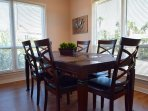 Dining table on the main level just off of the kitchen and open to the living area.