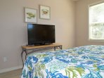 Enjoy a large TV in the king bedroom.