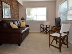 The lower level living area has a sleeper sofa and TV.