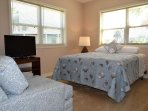 This bedroom is on the lower level and has a queen bed and TV.
