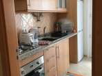 Kitchen with washing machine, oven and microwave and all utensils and items needed