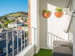 Balcony with nice and soft artificial lawn.