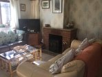 The lounge area with our newly installed log burner for the cosy winter evenings