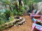 Cozy backyard with firepit and sitting area.  Overlooking a small water feature and the private pool