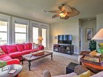 Lounge around on the cozy couches in the living room while watching your favorite TV shows.