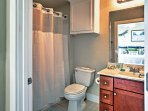Freshen up for the day in this pristine bathroom - one of 2 en suite bathrooms found in the unit!