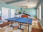 Bring out your competitive side while playing ping-pong in the Beach Club game room.