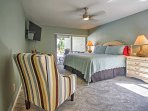 The marvelous Master Suite offers a plush king bed and direct patio access.