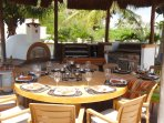 Palapa has a huge stainless gas grill, Argentinian charcoal grill, wood burning oven, buffet  & bar.