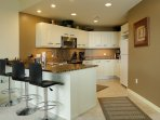 Full gourmet kitchen with all the appliances and cookware for family dining, prep and entertaining,