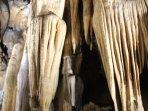 Visit the extensive caves of Clamouse near St-Guilhem-le-Desert