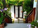 Enter the villa through tropical gardens