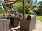 Outdoor lounge surrounded by beautiful gardens