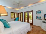 The Garden Master Suite opens onto the tropical gardens and features a flat screen cable television