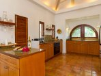 The fully equipped granite counter kitchen features state-of-the-art appliances