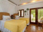 The Guest Suite Bedroom can be set up as two twins or a king bed