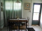 Table seats 4 for eating or gaming. Front entry door.
