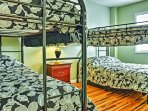 Both kids and adults will love choosing between the top and bottom bunks of these bunk beds!