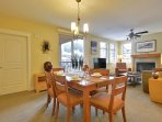 6-Chair Dining Table and View of Spacious Living Room with Glass Patio Door
